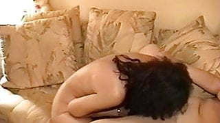 Two lesbians with unshaved pussies entertain each other in a yellowish room
