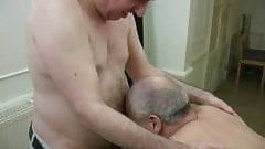 two mature daddies on massage table