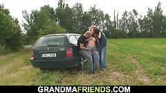 Sexy grandma gets double penetration outdoor