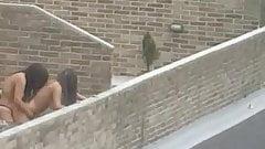 Mistress fucks her whore on rooftop balcony