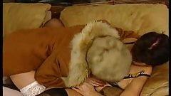 Mature in fur coat in strapon session