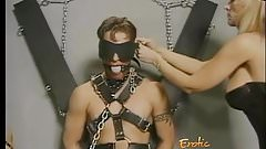 Horny stud enjoys having his throbbing boner tied up by two