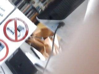 Nipslip upskirt Busty black girl filmed in the library - slight nipslip