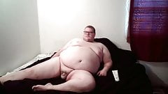 Fat man playing with his small cock