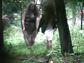 Girl pissing outdoor - Voyeur is spying and recording two girl pissing in the wood