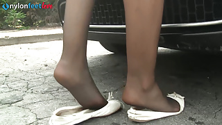 Sexy redhead stockings upskirt and shoeplay on the driveway