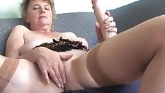 Slut grandma masturbating with a big dildo