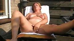 Mature with saggy tits masturbating and toying