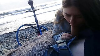 The girl sucked right on the beach near the sea!