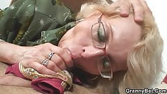 Shaved pussy grandma pleases young boy
