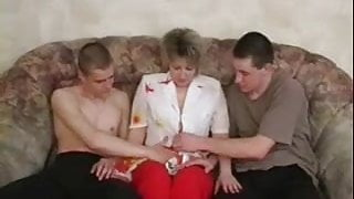 Russian mature fucking with two young on the couch