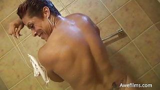 FBB topless flexing in shower