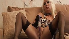 60 something blonde in black sheer stockings masturbates