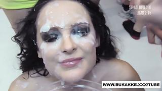 Smokey eyed girl gets painted white with cum - bukkake.xxx