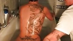 Tattooed girlfriend fisted in the bathtub