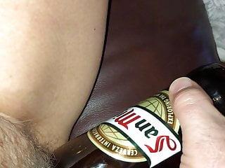 Pussy opening beer bottle Beer bottle