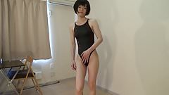 crossdresser in a black swimsuit