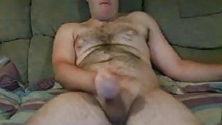 Hairy cub wanking on cauch