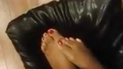 Caressing the leather pillow feet