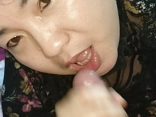 Asian blow up dolls - Chinese friend blows my cock, looking at the camera 3