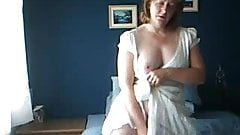 mature wife dildoing in the bedroom