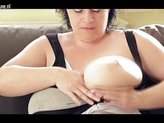 Natural tits moms Mom with big natural tits sucking a hard cock