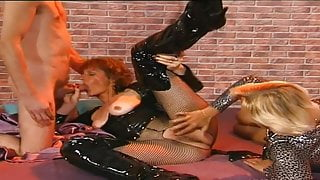 Classic beauty in thigh high boots and PVC gets fucked