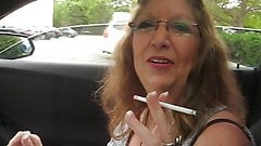 Pretty Grandma smokes in the car