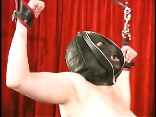 Mistress latex cane - Hooded corseted chick with big tits gets shackled and caned