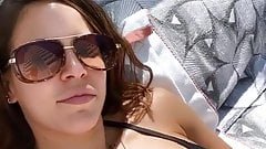 WWE - Charly Caruso sunbathing in a black bikini