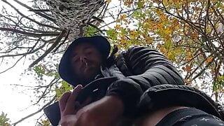 Muscular guy bodybuilder is jerking off in forest outdoor