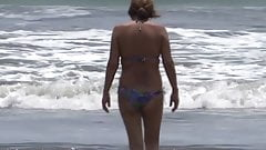 58-YEAR-OLD HAIRY MOTHER IS SHOWN IN BIKINI ON THE BEACH