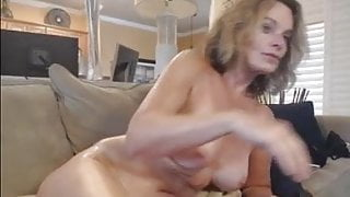 Big tits mature toying her pussy.