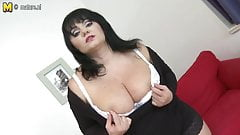 Big breasted mother playing with her toy