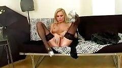 MILF fingering her pussy