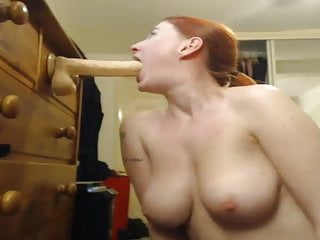 Suck it down all the way Camgirl goes all the way down on a huge dildo