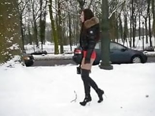 Norwegian lingerie in the snow Hooker wearing thigh high boots snow walking