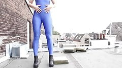 Daring peeing and teasing at rooftop in blue spandex catsuit