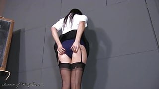 Another Sixth Former Caned in Short Skirt and Stockings