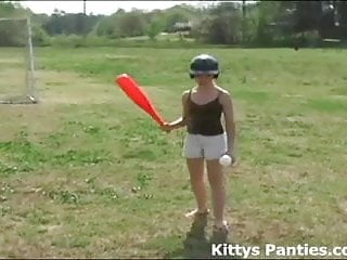 Adult softball association Innocent teen kitty playing softball outdoors