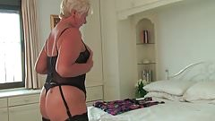 Curvy granny in black stockings