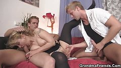 Sexy old lady takes two cocks from both ends