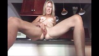 Blonde milf masturbating in the kitchen and cum