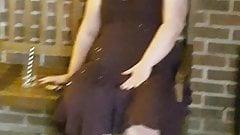 Slut fingers herself on bench