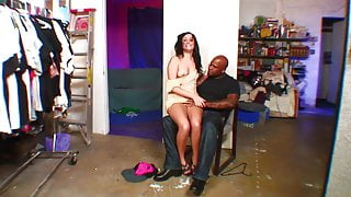 Brunette with small tits deep throats black cock on the sofa