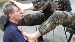 A lucky guy is allowed to lick the boots of German soldiers