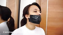 Fragiledesires Tape Gagged and Tied in Tape Bondage