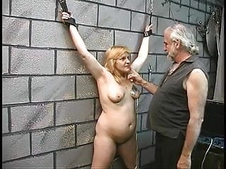 Sexy mature doms - Slave gets bound with leather cuffs and dom gives her electric shocks in nipples