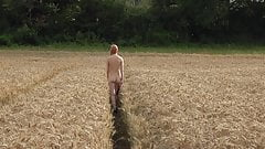 Kourtney walks naked amongst the crops near Cheltenham, UK