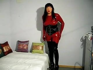 Doll to have sex Doll in latex catsuit and female mask have some fun